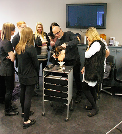 Kiri from Paul Mitchell demonstrating hair cutting at Eltham salon training