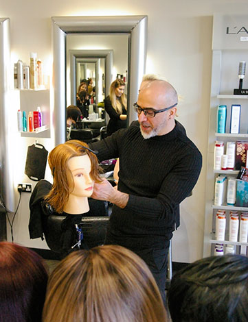 Kiri from Paul Mitchell demonstrating hair cutting at Woolwich salon training